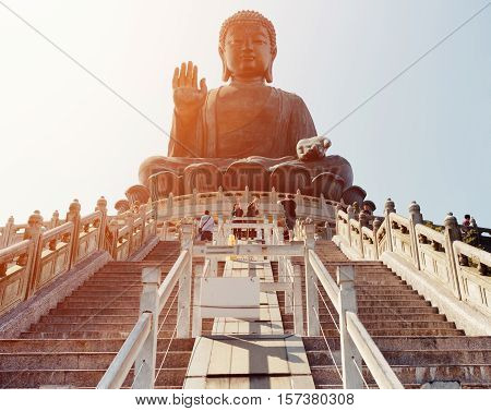 HONG KONG - JANUARY 29 2015: Tian Tan Buddha (the Big Buddha) in sunlight. It is a large bronze statue of a Buddha Amoghasiddhi in Hong Kong. Hong Kong is popular tourist destination of Asia.