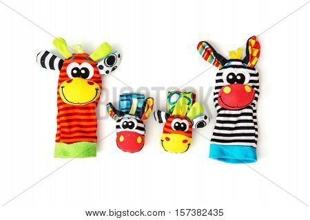 Colorful hand puppets and wrist pals on the white background. Funny toys. Vibrant colors.