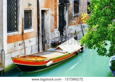 Boat Parked Beside Old House On Rio De S. Cassan Canal, Venice