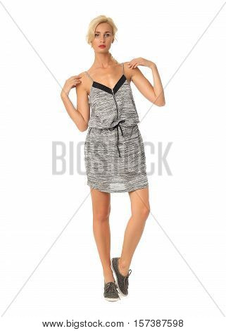 Portrait Of Flirtatious Woman In Gray Tunic Dress Isolated On White
