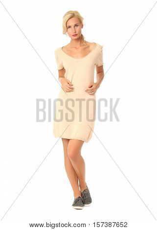 Full Length Of Flirtatious Woman In Yellow Dress Isolated On White