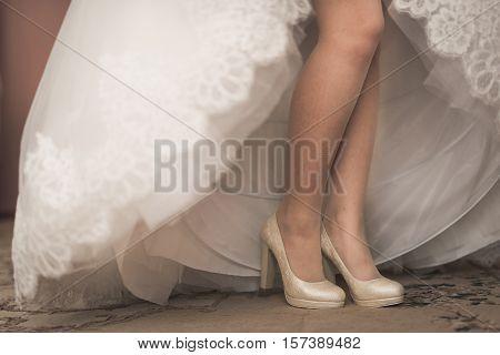 Macro Photo Of White Wedding Shoes