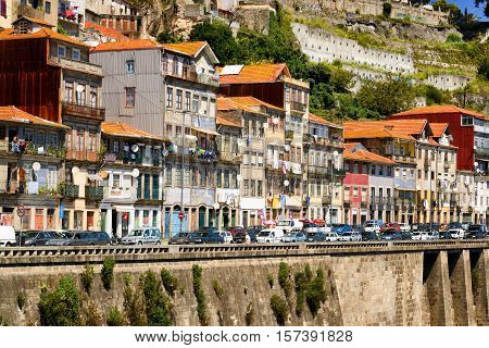 Colorful Facades Of Old Houses On Embankment Of The Douro River In Porto, Portugal.