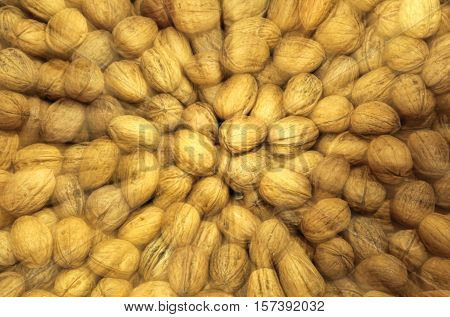 Background With Blurred Motion Of Many Ripe Walnuts