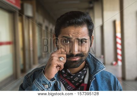 Indian Man Posing In An Urban Context.