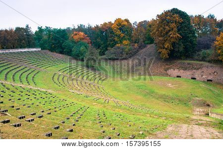 Autumn Colours With Trees In The Park. Abandoned Amphitheater.