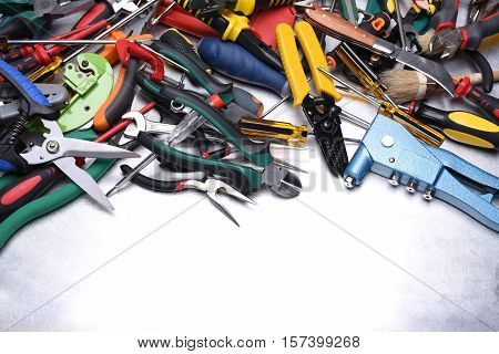 Set of tools on grey metal surface