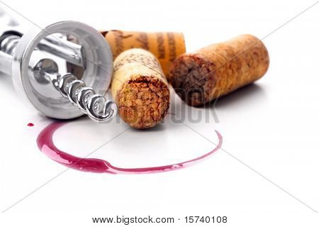 Corkscrew  and red wine stain over white background