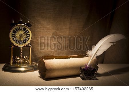 Literature concept. Old inkstand with feather near scroll and vintage clock on canvas background.