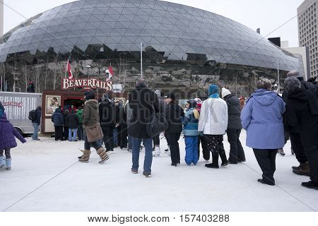 Ottawa, Ontario, Canada - February 05th, 2012: Long line-up at a Beaver tail shack on the Rideau Canal.