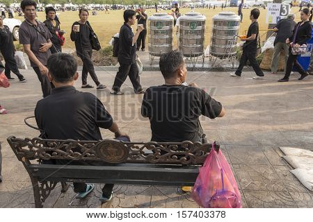 BANGKOK THAILAND - OCT 25 : snap shot of people in Sanam Luang area while the funeral of king Bhumibol Adulyadej in Grand Palace on october 25 2016