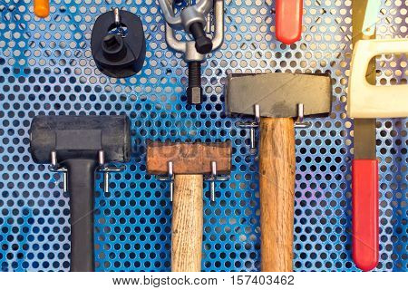 Collection Of Hammer Tools Tidy On Board In Garage