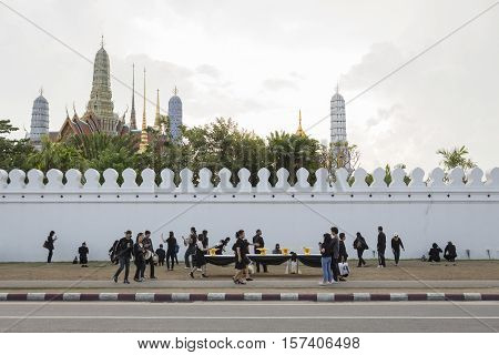 BANGKOK THAILAND - OCT 28 : crowd of mourners worship at wall of Wat Phra Kaew while the funeral of king Bhumibol Adulyadej in Grand Palace on october 28 2016