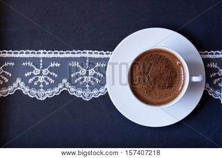 A cup of Turkish coffee on a black background