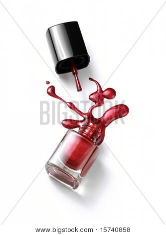 nail polish in glass bottle isolated on white background. liquid splash. nail polish drop