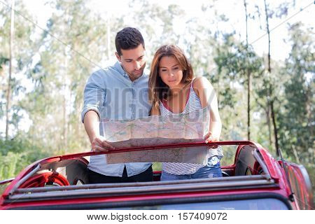 Happy young couple on roadtrip through countryside