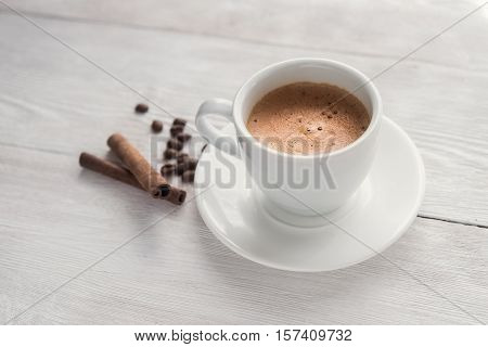 Hot cappucino cup on a white table