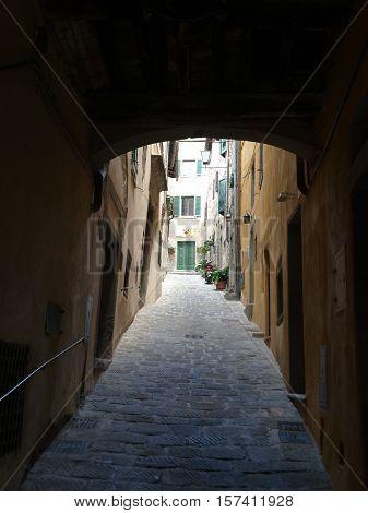 narrow street of Cortona in Umbria. Italy