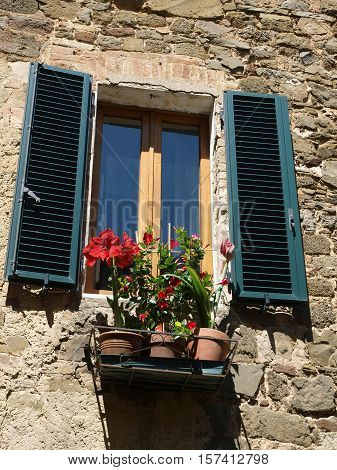 Montalcino - stone architecture and flowers. Tuscany, Italy