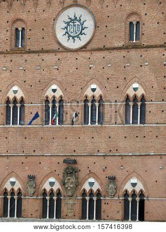 Siena - Gothic Palazzo Pubblico facade. Tuscany, Italy