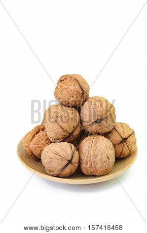 Walnuts in a bowl isolated on white background