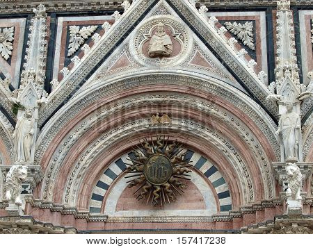 Siena - marble Duomo portal. The Duomo of Siena which was built in the 12th and 13th centuries is one of the prettiest churches in Gothic style in Italy
