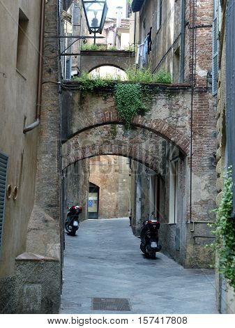 Picturesque street in antique center Siena Tuscany Italy
