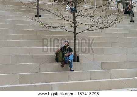 Chicago IL USA - September 25 2015: People are resting on the steps near Chicago river.