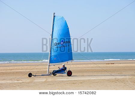 Sailing Buggy At Beach With Blue Sky