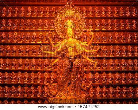 Golden statue of goddess Guanyin at Hainan China