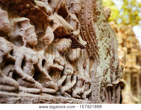 Ancient Bas-relief At Ta Prohm Temple In Angkor, Cambodia
