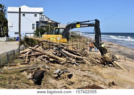 VILANO BEACH, FLORIDA, USA - OCTOBER 19, 2016:  Heavy construction equipment clearing beach debris caused by hurricane Matthew hitting along the east coast of Florida on October 7, 2016.