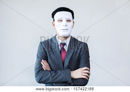 Businessman In Disguise Mask In White Background
