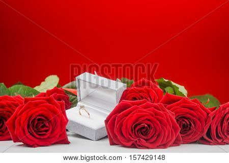 Arrangement Of Roses And Golden Ring