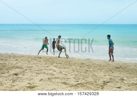Great Corn Island Nicaragua - July 10 2015: Local teens play football on the beach by the Caribbean in Great Corn Island, Nicaragua