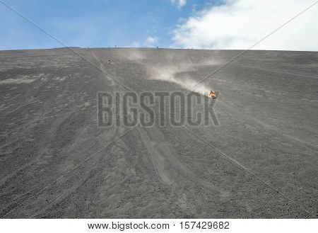 Volcano boarding is a super fun activity for adventurous travelers. Cerro Negro Volcano near Leon, Nicaragua. Shallow DOF