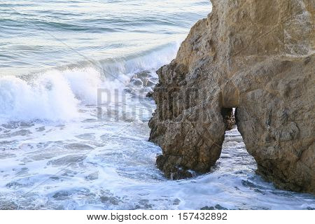Natural Bridge In The Surf