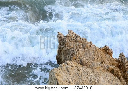 Rock In The Surf