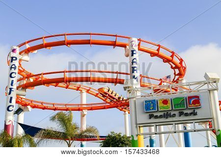 SANTA MONICA, USA - MAY 30, 2015: West Coaster rollercoaster in Pacific Park with people taking a ride.