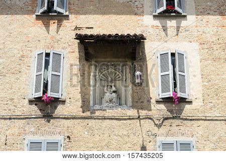 Fagnano Olona (Varese Lombardy Italy): the medieval castle built in the 15th century: a bas-relief