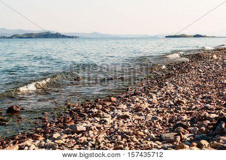 Waves hitting big rocks on Lake Baikal