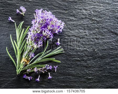 Bunch of lavandula or lavender flowers on graphite board.