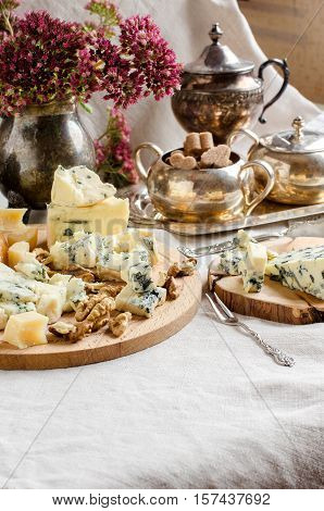 A Beautiful Table Setting. Different Varieties Of Cheeses.