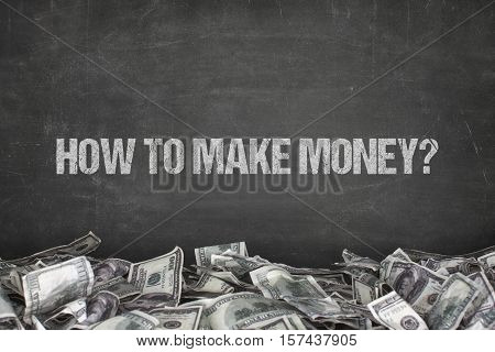 How to make money  text on black background with dollar pile