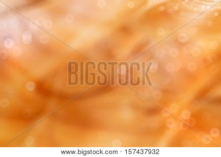 Orange bright abstract background with bokeh. Festive substrate for holiday text
