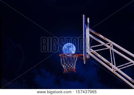 moon in a basketball hoop . business concept success concept