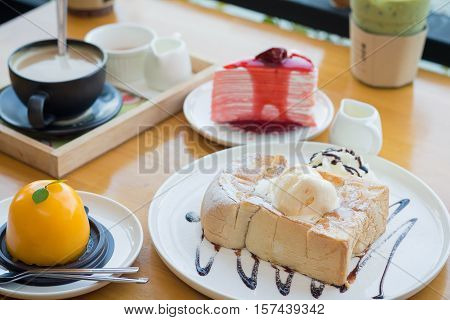 Honey toast with strawberry cake and hot coffee. Honey toast in cozy outdoor cafe.(selective focus)