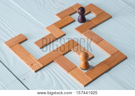 Two people inside the Maze. The concept of a business strategy analytics search for solutions the search output.