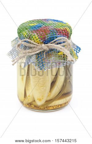 pickled cucumbers in jar on white background