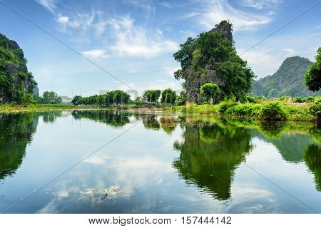 Beautiful Natural Karst Towers Reflected In The Ngo Dong River